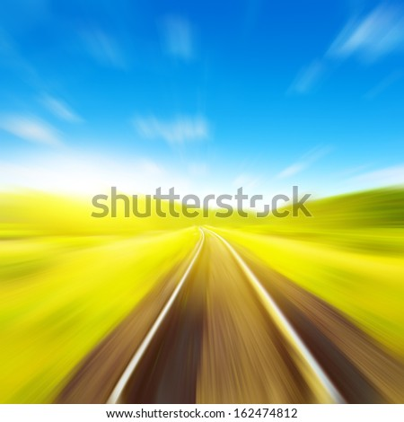 Railway in motion blur on  summer day.  - stock photo
