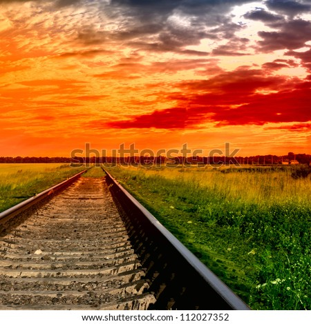 Railway into the bloody sunset - stock photo