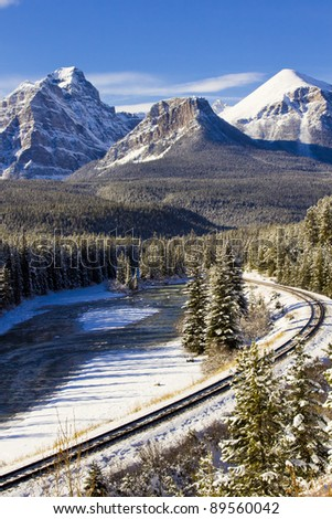 Railway line through the winter wonderland of the Canadian Rockies