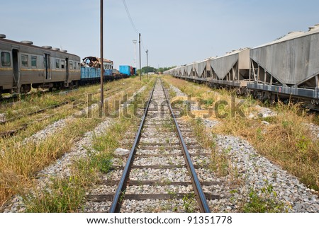 Railway looking forward with train wreckage on the left, taken on sunny day, can be use for safety related communication - stock photo