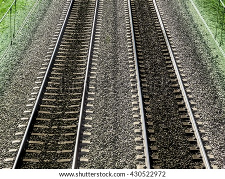 Railway reflecting the continuous passage of the train - stock photo