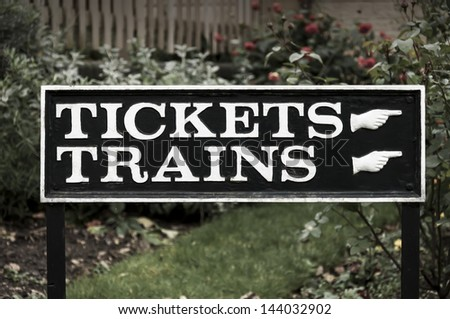 Railway sign for tickets and trains - stock photo