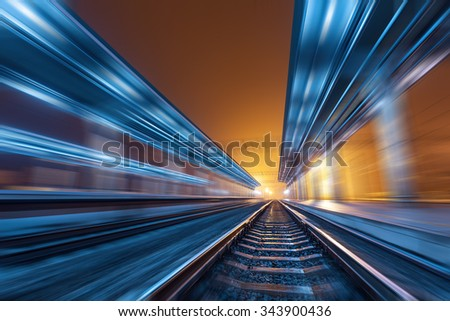 Railway station at night with motion blur effect. Cargo train platform in fog. Railroad - stock photo