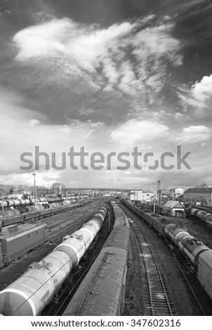 Railway station. Cargo transportation of goods by rail. Train with storage tank. Black and white photo - stock photo