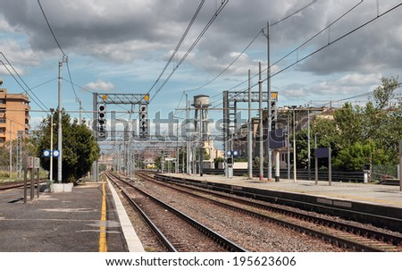 railway station under cloudy sky