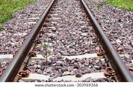 Railway track in sunny day - stock photo