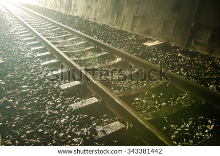 Railway track in tunnel - stock photo