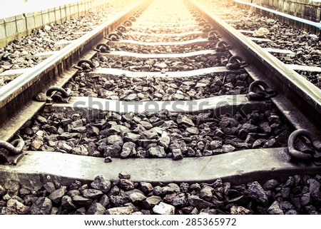 railway track in vintage color filter - stock photo
