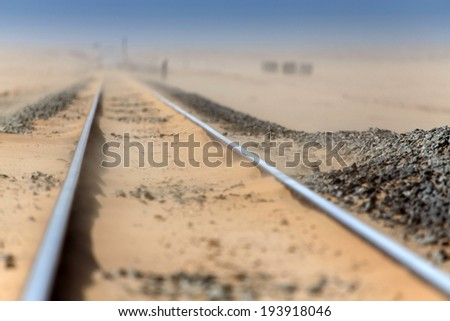 Railway Track Leading Through the Namib Desert, Namibia, Africa - stock photo