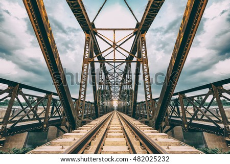 Railway track on the bridge steel structure in countryside., Retro color style