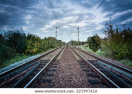 railway track with a background of clouds - stock photo