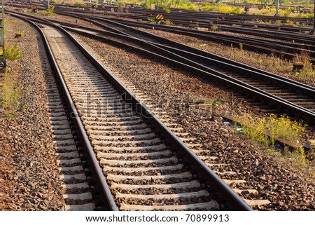 Railway Tracks and Switch near Train  Station. - stock photo