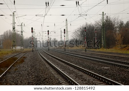 Railway tracks and switches with signals - stock photo