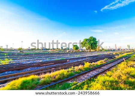Railway Tracks at a Major Train Station at Sunrise. twilight, Bangkok Thailand - stock photo