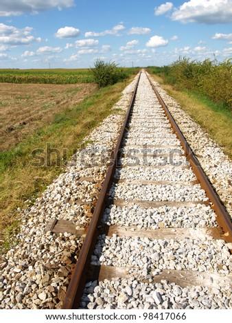 railway tracks in a rural scene - stock photo