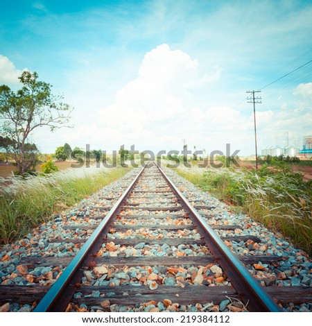 Railway tracks in a rural scene. pastel style. - stock photo
