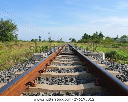 Railway tracks in a rural scene with sunny day. It is classical railway.