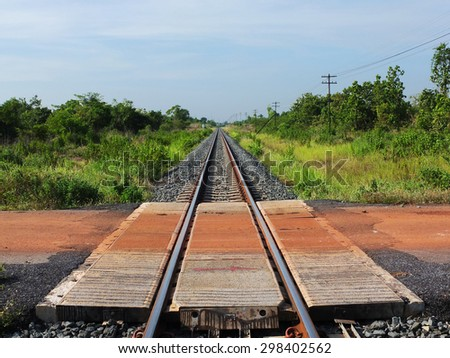 Railway tracks in a rural scene with sunny day. It is classical railway. - stock photo