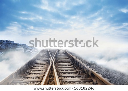 Railway tracks leading to clouds