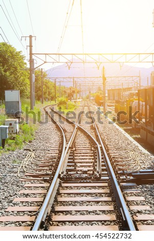 Railway tracks switching direction to Detroit destination with sunlight - stock photo
