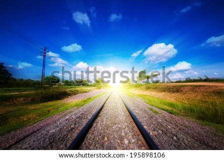 railway tracks  under blue sky go to success - stock photo