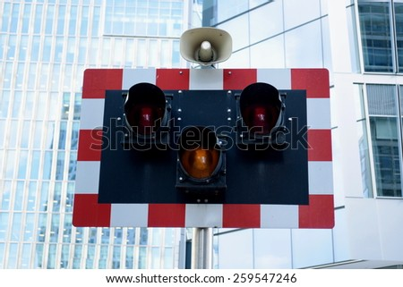 Railway traffic light with speaker - stock photo