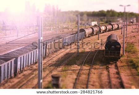 Railway wagons with coal standing on the tracks: the view from the top - stock photo