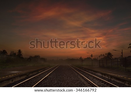 Railway way at the Dusk or in the Morning with Dramatic Lighting - stock photo