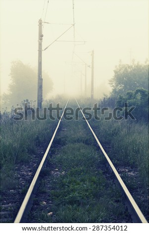 Railways at foggy weather morning - stock photo