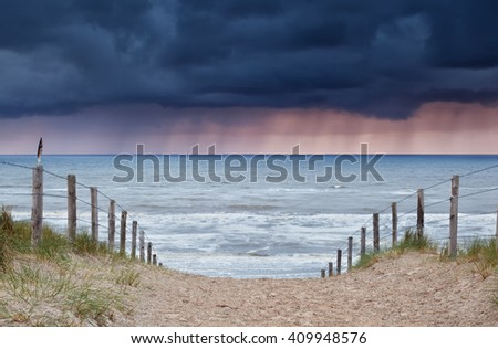 rain and storm coming from North sea to beach, Holland - stock photo