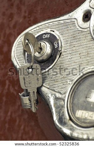 rain covered keys in a rusting auto ignition - stock photo