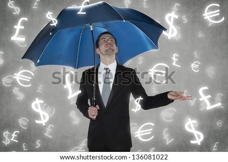 rain currencies - stock photo