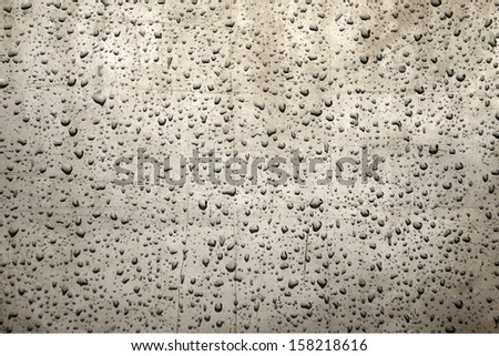 Rain drops on a metal surface - stock photo