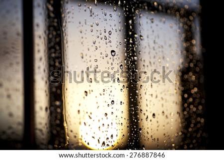 Rain drops on a window - stock photo