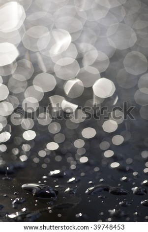 rain drops on black car