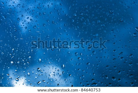 rain drops on car window - stock photo