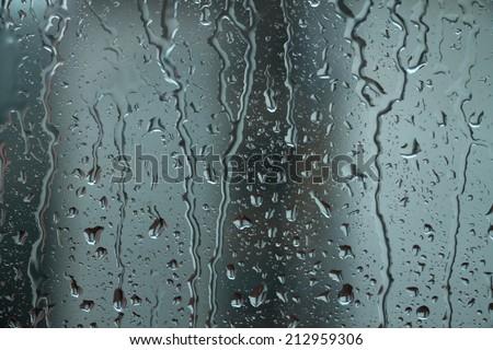 Rain drops on window,rainy day - stock photo