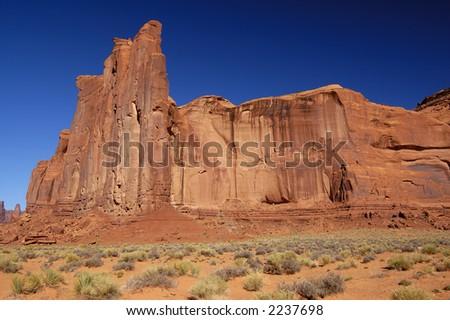 Rain God Mesa in Monument Valley (Navajo Nation, Utah) - horizontal orientation. - stock photo