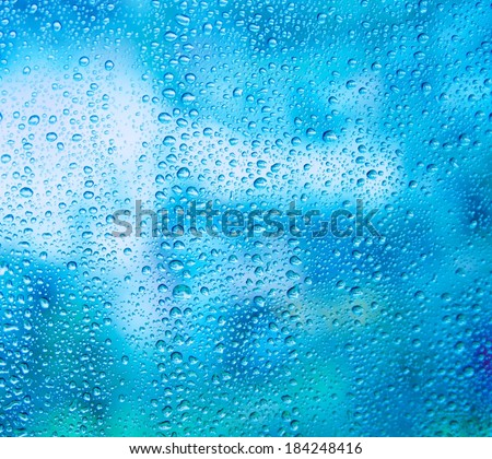 rain on glass rain outside the window - stock photo