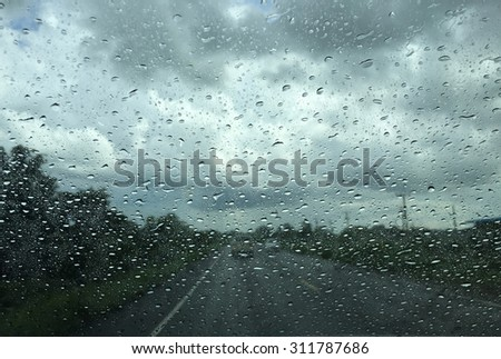 Rain on road view from window car - stock photo