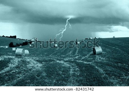 rain with lightning on the hill - stock photo