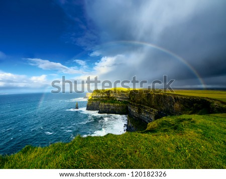 Rainbow above Cliffs of Moher. Ireland. - stock photo