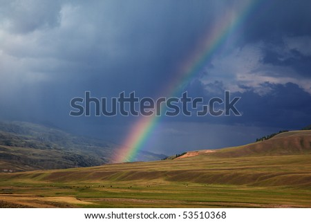 Rainbow after storm in the mountains of Almaty region national park Assy - stock photo