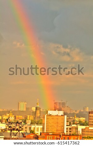 Rainbow after the rain over the city. Moscow.