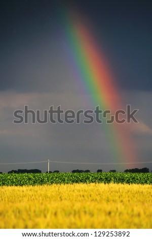 Rainbow against a stormy sky - stock photo