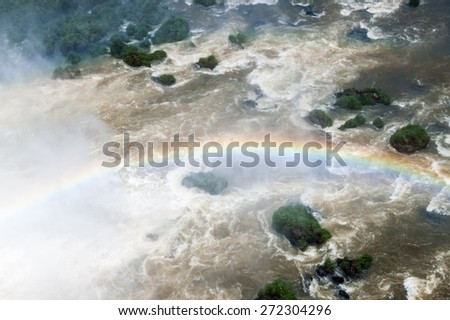 Rainbow at Iguacu (Iguazu) falls on a border of Brazil and Argentina - stock photo