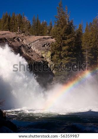 Rainbow at White Cascade.  Glen Aulin High Sierra Camp - stock photo