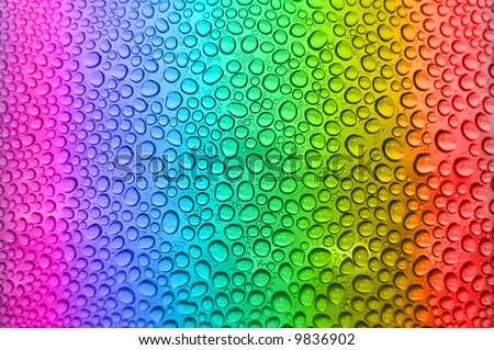 Rainbow background with water drops - stock photo