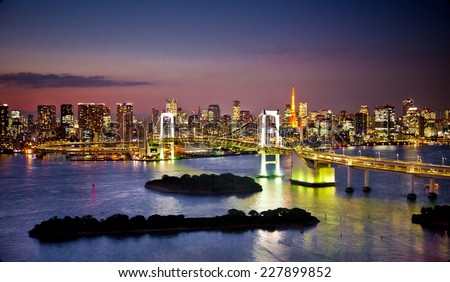 Rainbow Bridge and Sumida River in Tokyo, Japan. Night photo. - stock photo