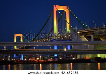 Rainbow Bridge at night, Tokyo - stock photo